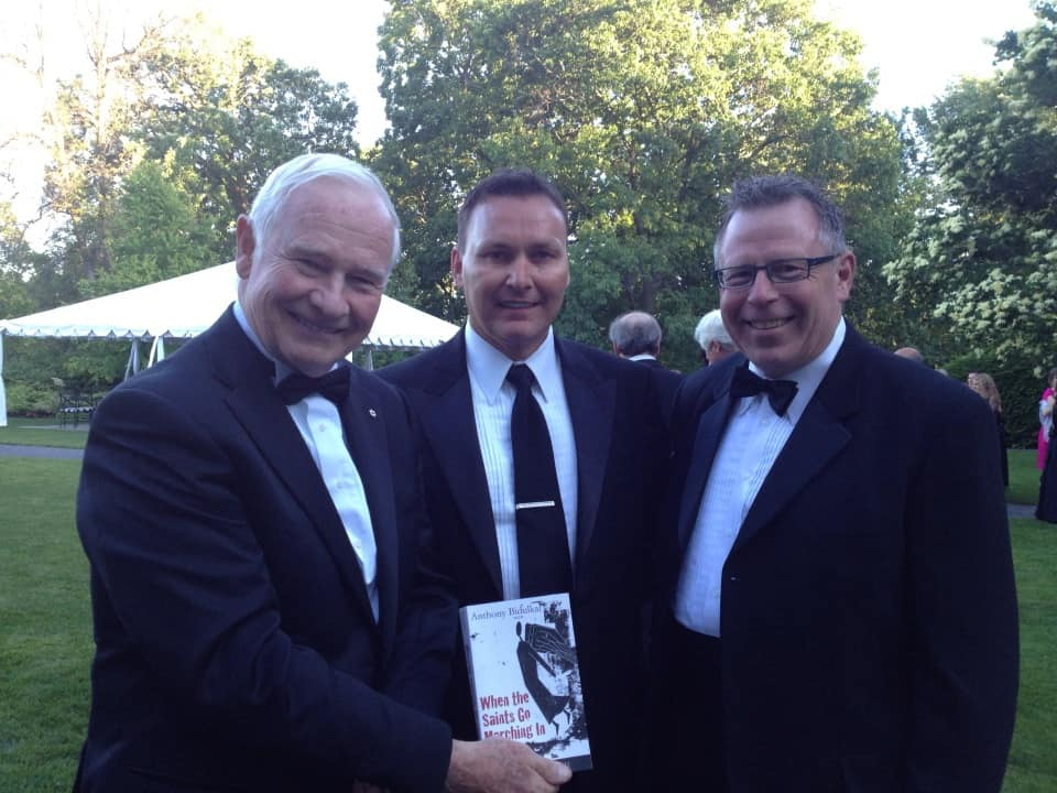 Governor General of Canada David Johnston being presented copy of When The Saints Go Marching In by Paul and Bill