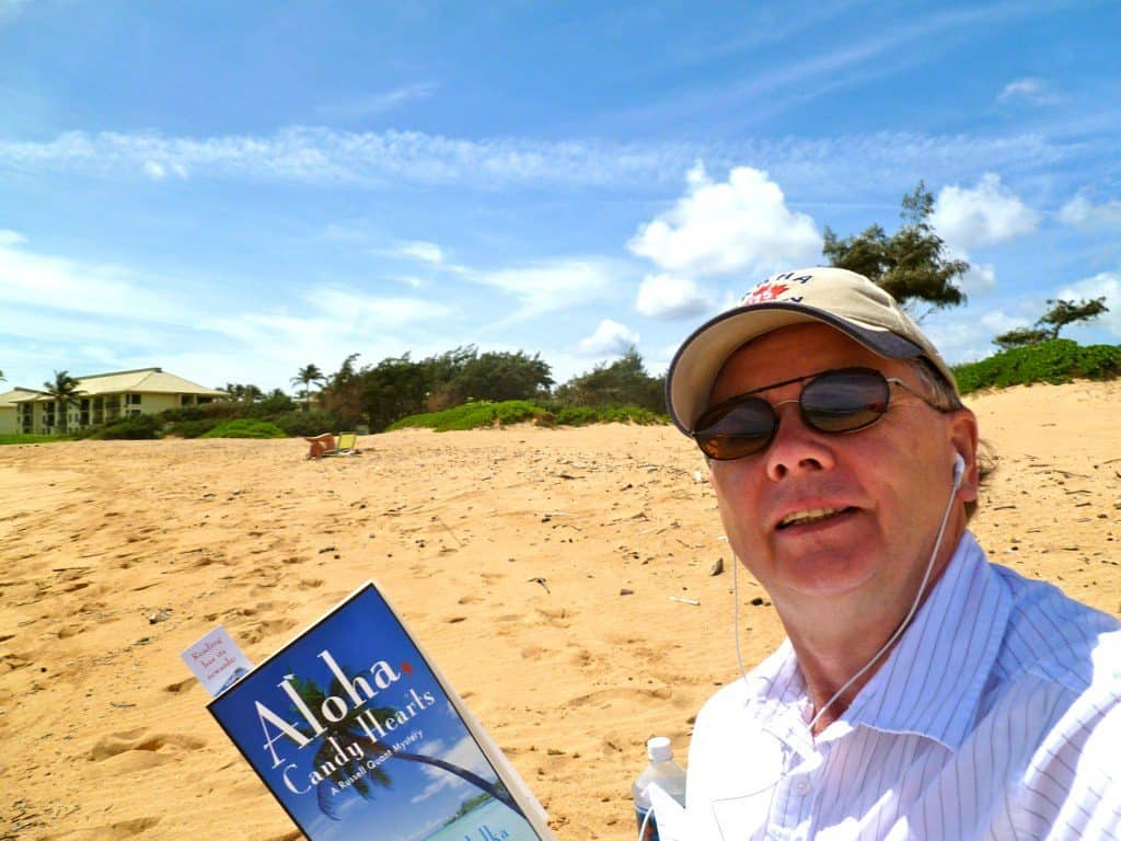 Sent in by Jim Rudd enjoying the Coconut Coast of Kaui with an appropriately titled book.