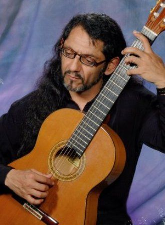 Rodolfo Pino Robles, our talented Spanish guitar player